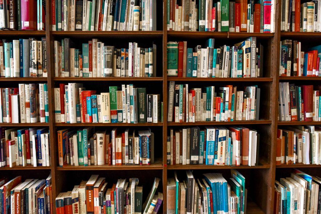assorted books on shelf 1370295