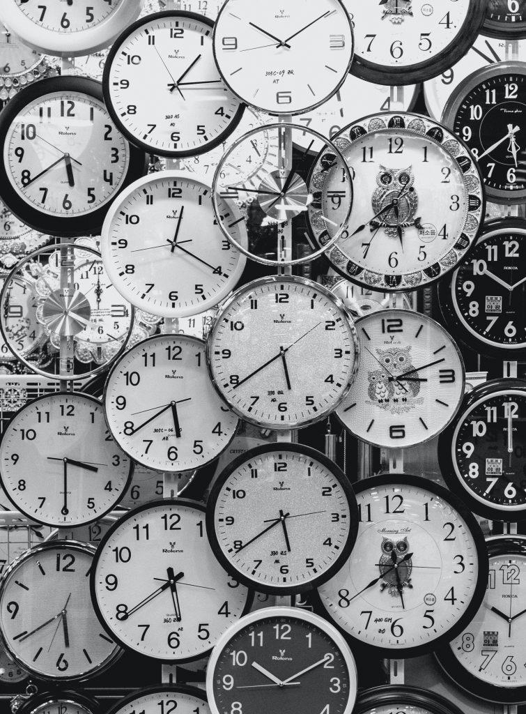 black and white photo of clocks 707676 1